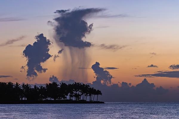 Small raincloud at sunset