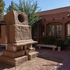This photo and two others are of a robot sculpture in the style of pueblo architecture