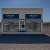 "This is an art installation that is actually closer to Valentine, TX than to Marfa. <br /> <br /> <a href=""https://en.wikipedia.org/wiki/Prada_Marfa"">https://en.wikipedia.org/wiki/Prada_Marfa</a>"