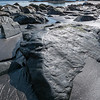 At low tide the beaches may appear dramatically rocky