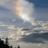 "A ""sun dog"" caused by sunlight striking ice crystals in high cirrus clouds"