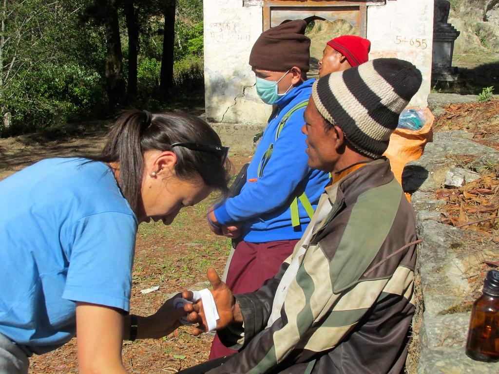 an Aythos volunteer provides medical support to villagers after the Nepal earthquake