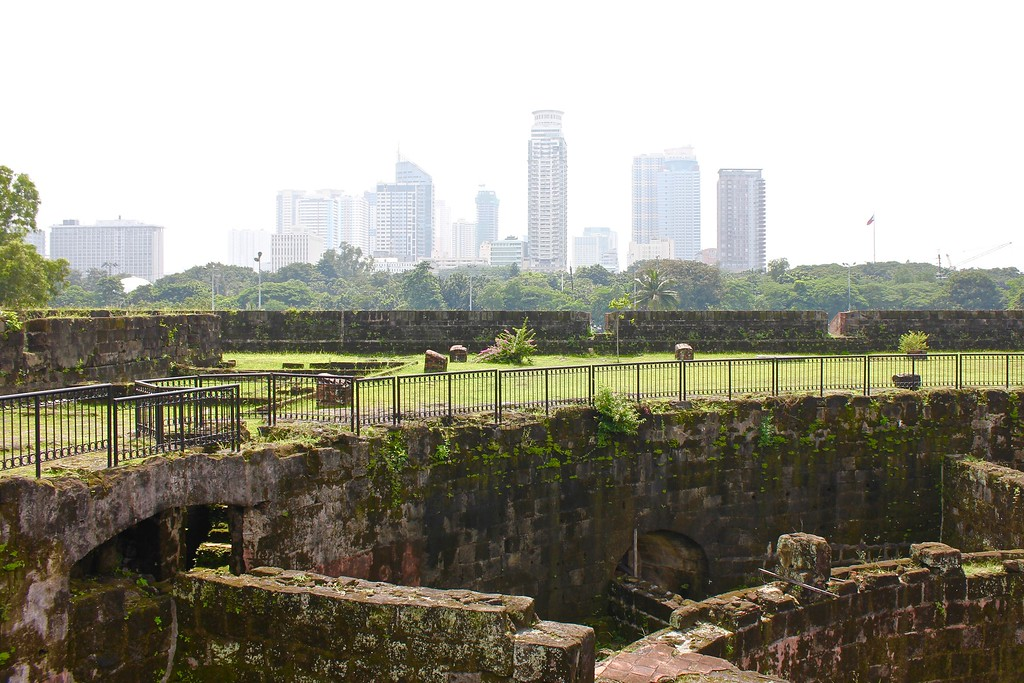 the view of Intramuros and the Manila skyline from Puerta Real Gardens in Manila, the Philippines