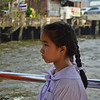 Thai girl in her school uniform on the tourist boat