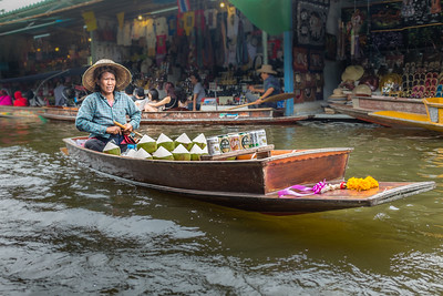 Coconuts and beer for sale in the khlong (canal) market in Bangkok, Thailand