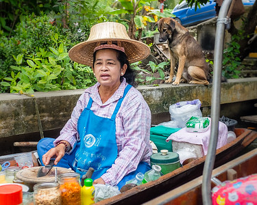 Food boat in the khlong (canal) in the river market in Bangkok
