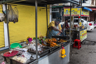 Chicken on a stick at the Day Market in Bangkok, Thailand