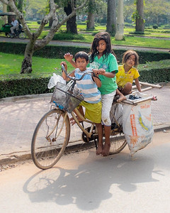 Beggar children collecting cans and plastic bottles in Siem Reap, Cambodia