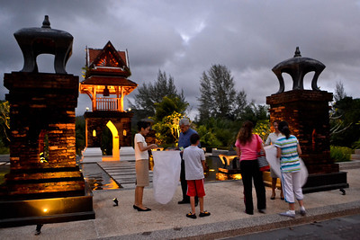 Staff helping guests unfold their lanterns
