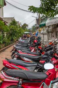 Motorbikes are the primary mode of transportation all over Southeast Asia--here at the morning market in Luang Prabang, Laos