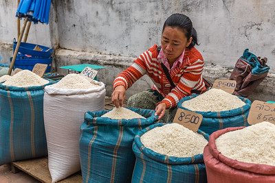 Rice vendor at the morning market in Luang Prabang, Laos
