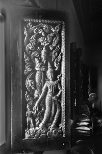1000 year old carved office window in the Xieng Thong temple in Luang Prabang, Laos
