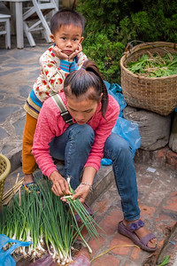 Boy and his mother at the morning market in Luang Prabang, Laos