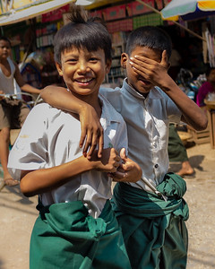 Two young boys in school uniforms at the day market in Bagan, Myanmar