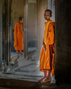 Angkor Wat, Siem Reap, Cambodia, Young monk begging inside the ruins