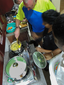Christian learning how to cook Sri Lankan Curry