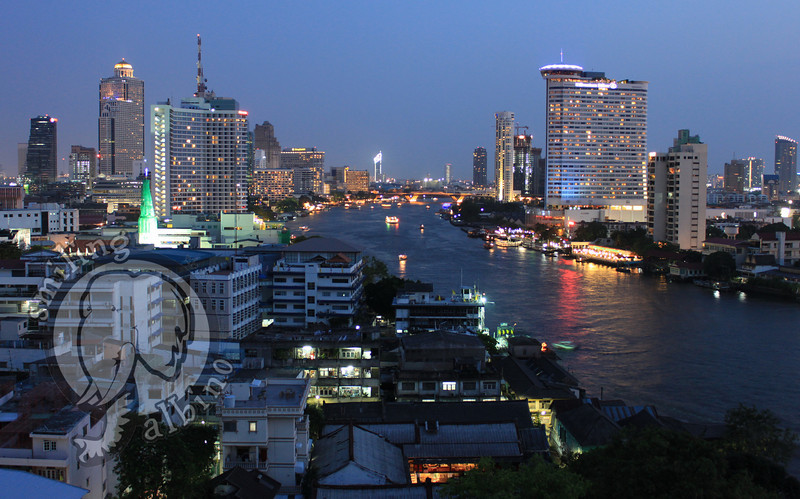 The sun sets on the Chao Phraya River.