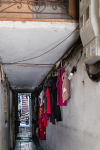 Passageway from the street to apartments in Hanoi, Viet Nam