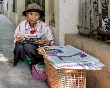 Newspaper vendor in Hanoi, Viet Nam