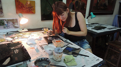 Sarah working on her lacquer painting