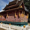 A smaller temple in the Vat Xieng Toung Monastery complex in Luang Prabang. I really liked the exquisite colored glass artwork on the outside (see close up in next picture for better detailed view).