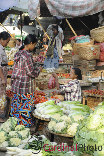 Burmese Women selling produce at the Wholesale central market in downtown Mandalay, Myanmar (Burma), Southeast Asia