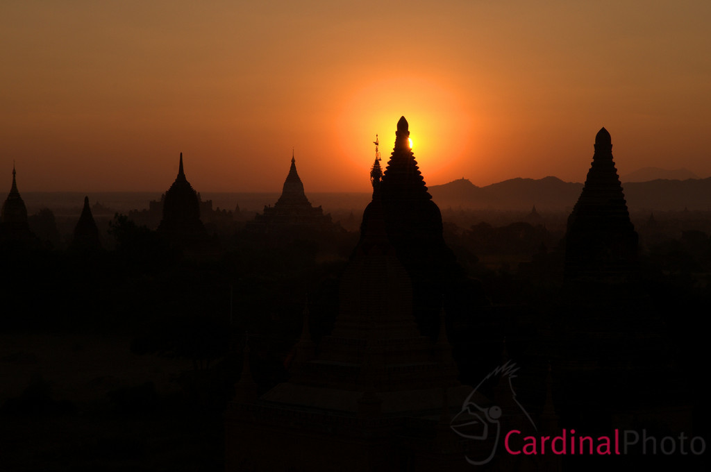 Sunrise over Bagan (Pagan), Plain of Temples, showing a silhouette of spires and temples in the distance, Myanmar (Burma), Asia