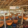 Burmese manufacture water filters for sale to other villages as part of Cyclone Nargis recovery effort, funded by Thirst-Aid and ATF