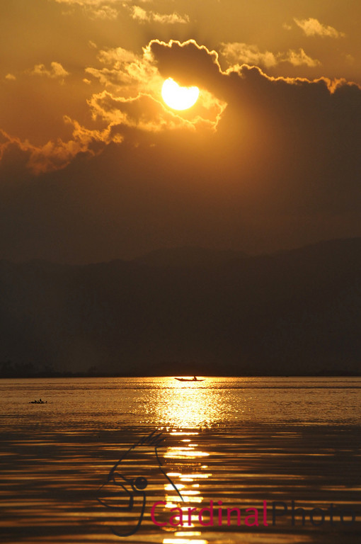 Golden Sunset through the clouds over Inle Lake Area, Shan State, Myanmar, Burma, Southeast Asia