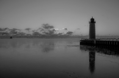 Sunrise, Dawn on Lake Michigan off Milwaukee Wisconsin. Pierhead Lighthouse.