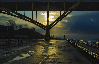 Sunrise. Under the Hoan Bridge. Pierhead Lighthouse. Lake Michigan, Milwaukee Wisconsin.
