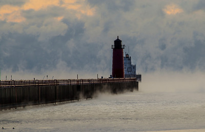 Cold winter morning in Wisconsin. Air temp 0 water temp 40 something. Pierhead Lighthouse Port of Milwaukee on Lake Michigan.