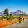 A yellow Piaggio tuktuk taxi returning to the larger town of the region, Ambalavao, Madagascar