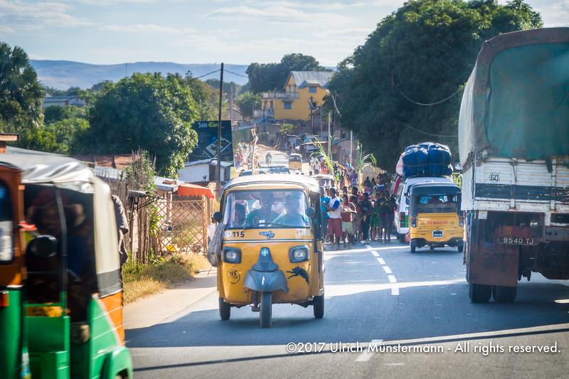 Yellow Piaggio tuktuks dominate the streets of Ihosy as taxis, Madagascar