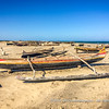 Typical Malagasy wooden fishing boats (piroga) beached, near Manombo, Madagascar