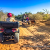 Letting a local zebu-drawn cart pass on a narrow track while on an offroad quad tour, near Ifaty, Madagascar