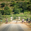 Locals attempt to repair the potholes in the national road and attempt to earn some money from passing vehicles rewarding them for their work, near Fatihita, Madagascar