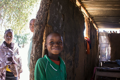 Curiosity gets the best of three students at Escola Primaria de Mafacitela in rural Mozambique.