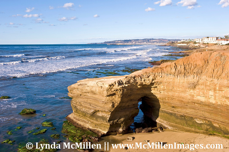 Sunset Cliffs keyhole slot exposed by ultralow King Tide (landscape).