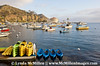 Kayaks awaiting paddlers in Avalon Harbor, Catalina
