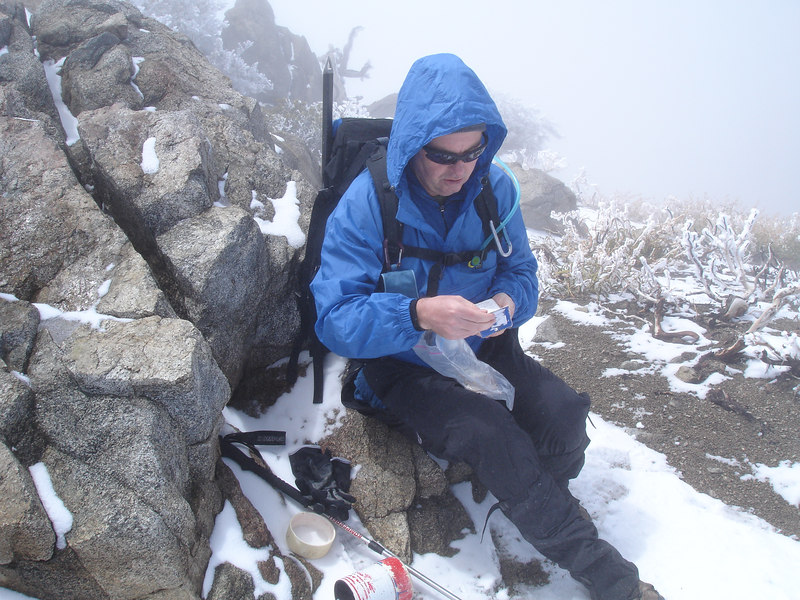 Rick checking the register on the summit of Cucamonga Peak.