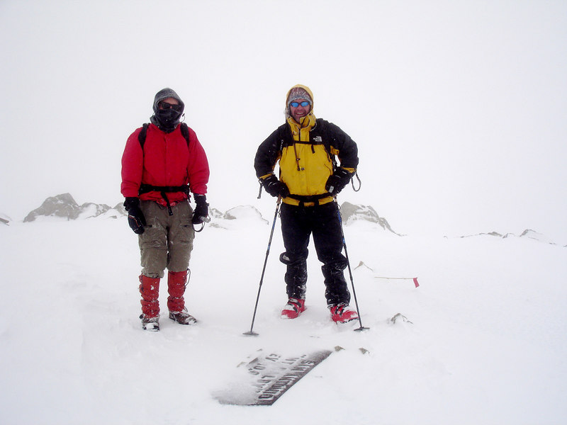 Mike and Bill on the summit in whiteout conditions. Because of the icy conditions, Bill stashed his skies below the summit. He skied down the chute we hiked up.