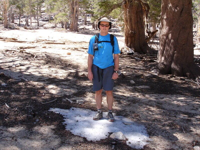 Rick standing on a tiny patch of snow.<br /> <br /> San Gorgonio Wilderness : South Fork : Dry Lake : San Gorgonio Mountain : Dollar Lake