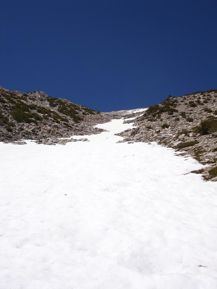 A snow chute leading to the summit of San Gorgonio Mountain, between Mine Shaft Saddle and the wreakage of a DC 3 on the Sky High Trail.<br /> <br /> San Gorgonio Wilderness : South Fork : Dry Lake : San Gorgonio Mountain : Dollar Lake