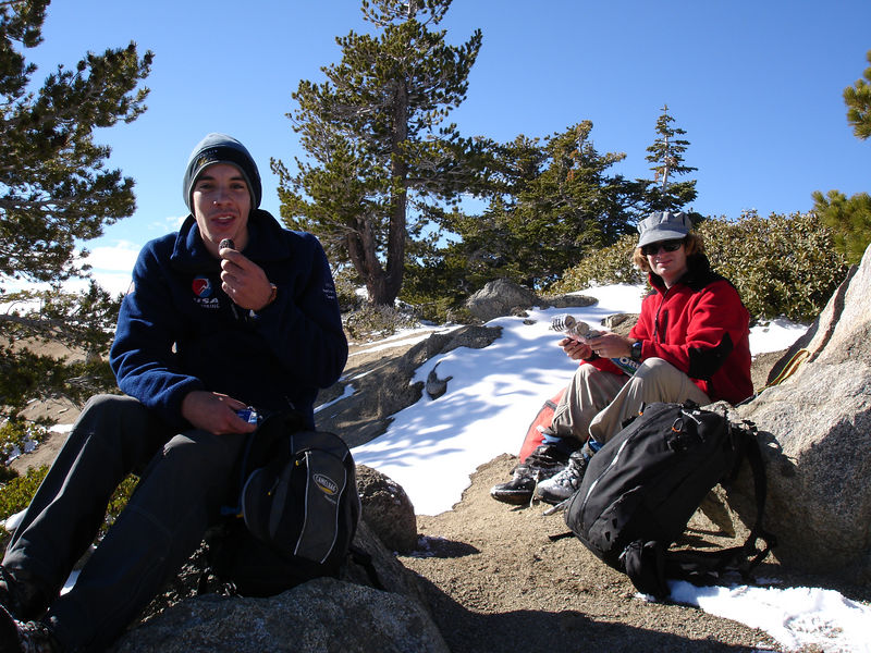 Alex and David snacking on the summit of Cucamonga.