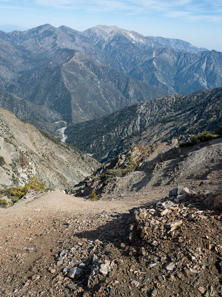 Unglaciated mountains don't get much more steep and rugged than the San Gabriel Mountains. Here you can see the San Gabriel River cutting through the Sheep Mountain Wilderness, and in the distance the 10,064 ft Mount Baldy. This view, from the north flank of Mount Baden-Powell, is one of my favorites in this mountain range.