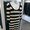 Owner of Southern Daisies Boutique in Leominster Jenna Charon talks about her new shop on Wednesday, Jan. 8, 2020. A French Connection sweater dress for sale in the new shop. SENTINEL & ENTERPRISE/JOHN LOVE
