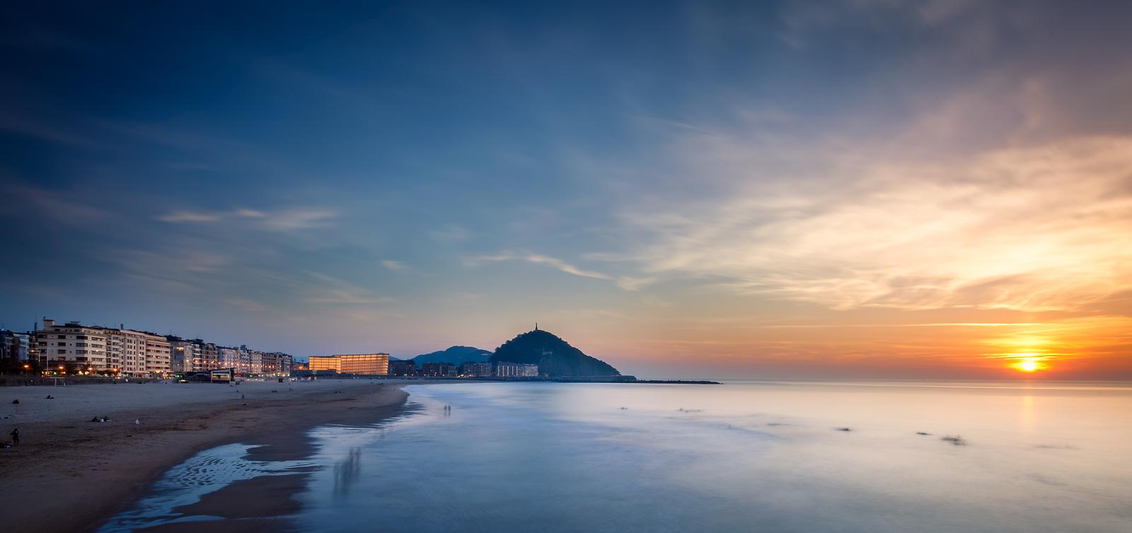 sunset over zuriola beach and mount urgull