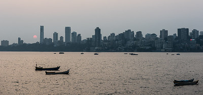 The view across the bay at sunset of Malabar Hill.  The exclusive residential area of the very wealthy in Mumbai.