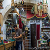 A master puppet maker works his craft in his shop in Siracusa Sicily.